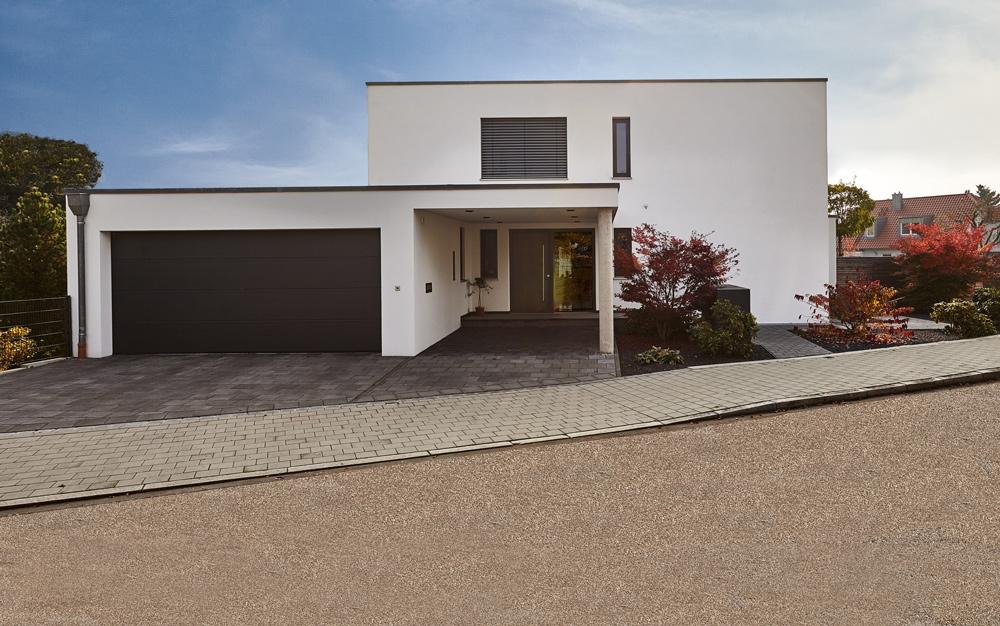 BSP, Bau, Bauträger, Einfamilienhaus, Flachdach, Garten, Terrasse, Garage